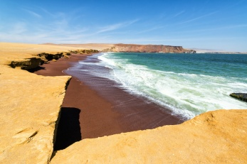 Red sandy beach called Playa Colorada near Paracas, Peru